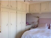 Vintage bedroom furniture - matching chests and fitted wardrobes. All in very good condition.