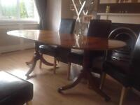 Yew wood extendable dining Table. Good condition. 3ft wide by 5ft long extending to 7ft .