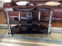 Smoked Glass and Chrome T V Stand . Excellent condition .