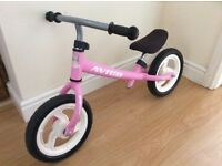 Kids balance bike in pink