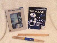 Drum sticks and books