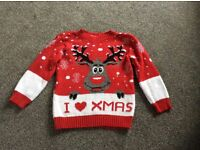 A boys Christmas jumper in a size 6-7 years in excellent condition.