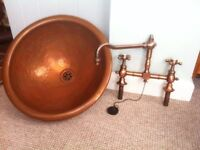 Round copper sink with matching taps
