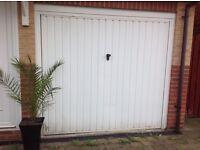 White manual garage door for sale.