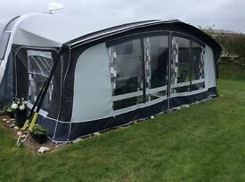 Dorema Awning, in very good condition,includes pegs, Awning carpet and 2 storm guys.