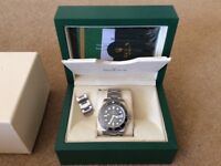 Rolex Submariner with Box and Papers