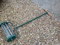Grass aerator,aerates the ground for lush green thick grass,l