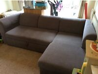 3 to 4 seater Light brown fabric sofabed with chaise and underbed storage