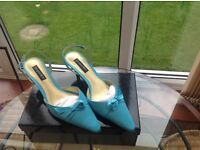 Jacques Vert, matching facinator, shoes and handbag in turquoise and navy.
