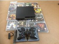 PS3 slim 250gb + games & more.
