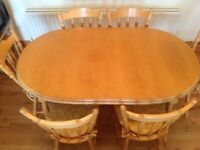 Oval Solid Wood Dining Table and Six Chairs
