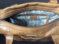 Osprey tan handbag