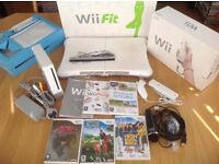 Nintendo Wii console, Wii Fit board, 3 games, instructions and original boxes