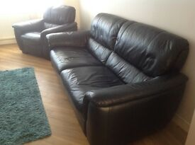 Large black leather settee and matching armchair
