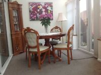Extending table and four dining chairs.