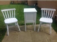 Two white solid pine chairs and side table