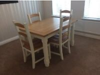 Table and 4 chairs - pine / wooden finish with white legs