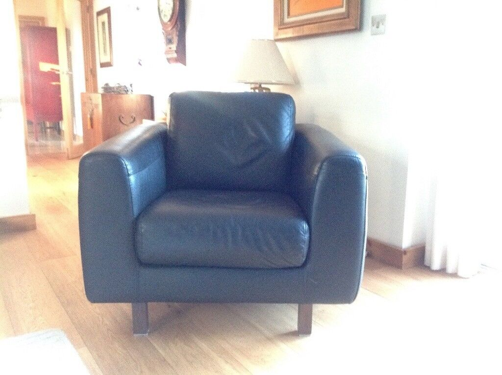 Two black leather Habitat armchairs