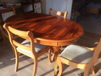 Extending oval dining table and 4 chairs