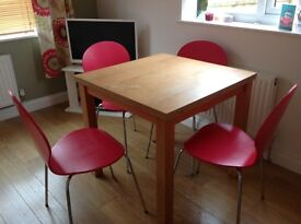 Modern raspberry pink set of 4 dining chairs.