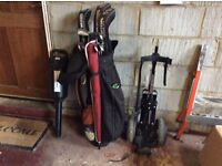 Golf clubs. Trolley. Bag. And balls.