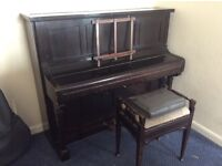 Upright. Overstrung piano