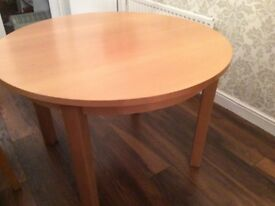 Round dining table extending to oval(4free chairs if wanted)