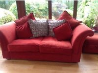 DFS suite, red fabric 4 & 2 seater settees & matching pouf. Also red leather arm chair .