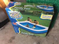 Large family inflatable swimming pool. Only used once. Been in storage since