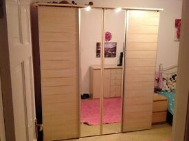 large 4 door beech/silver/mirrored wardrobe for sale. Excellent condition.