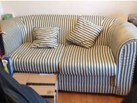Free 2 seater sofa in very good condition but needs a clean