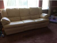 Three seater cream leather sofa with recliners