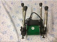 Salamander pump for increased shower pressure