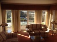Cream lined curtains with pelmet.