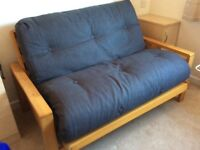 Sturdy Futon Sofa. Easily Transformed into a Flat Bed for unexpected Guests. As New only used on