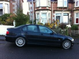 BMW Black Automatic Saloon. Beautiful car in good condition, but too fast for me