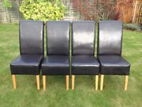 Four faux leather chairs