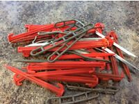 Red Plastic tent / awning pegs
