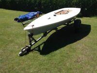 Laser Mk1 sailing dinghy c/w launching trolley & road trailer.