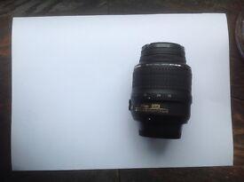 Nikon 18-55 VR standard zoom lens with filter, front & back caps
