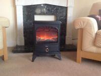 Electric log/wood burner effect fire. Three levels of heat control.