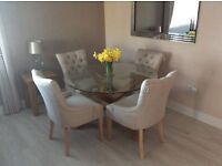 Round glass and oak dining table and 4 chairs only 2 months old excellent condition £350.00 Ono