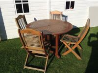 Teak round table and 4 chairs for the garden/patio £55 Ono tel 01332 853305/07966921804