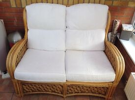 conservatory cane sofa and two chairs also three cane and glass tables