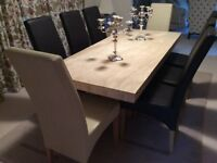 Travatine di g table and eight leather chairs