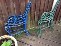 2 small pairs of cast iron garden bench ends.