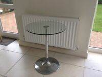 Glass and chrome bistro table
