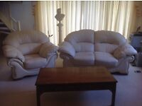 Immaculate cream leather two seater settee and armchair.