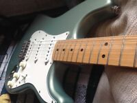 2003 Mexican Stratocaster in Ocean green metallic with Maple neck.£375