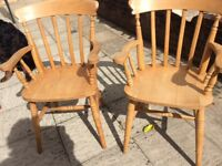 TWO SOLD PINE CARVER CHAIRS